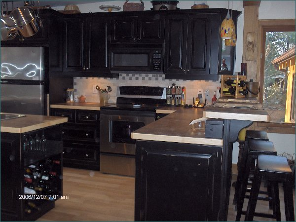 Painted black kitchen cabinets photos home improvement area Black cabinet kitchens pictures